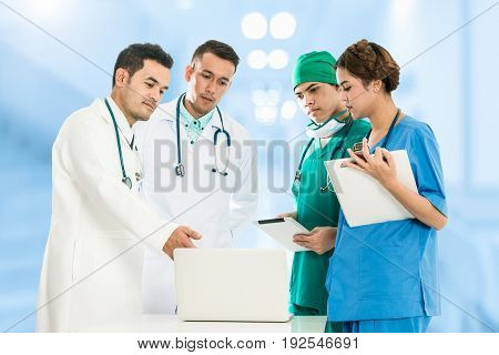 Medical People Group Meeting - Doctors Group Including Surgeon Nurse And Doctor In Meeting Discuss On Computer For Illness Diagnosis. Concept of Doctor Data Analysis Medical Teamwork.