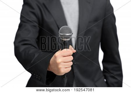 Reporter grabbing microphone with hand to interview. Isolated white background
