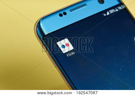 New york, USA - June 23, 2017: Flickr application icon on smartphone screen close-up. Flickr app icon with copy space on screen