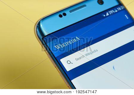 New york, USA - June 23, 2017: Wikipedia application search menu on smartphone screen close-up. Using wikipedia app