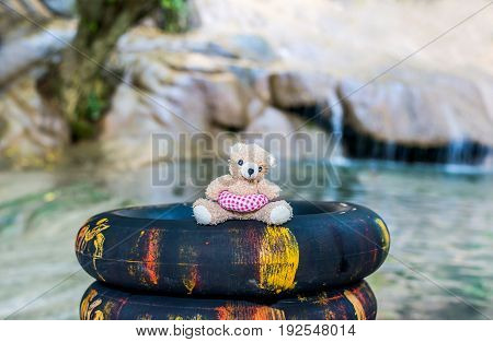 Teddy bear doll relaxing and lonely vintage style