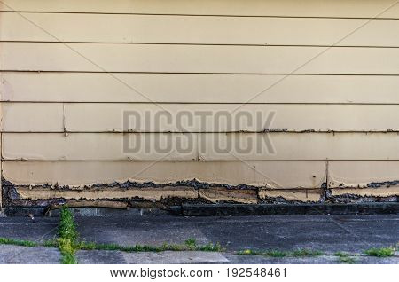 rotting old clapboard siding on an old garage