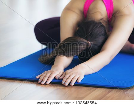 Woman Practicing Yoga Pose In Gym