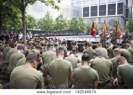 Military Freedom Run: U.S. Marine Corps personnel bow their heads for a moment of silence by the reflecting pool at the National September 11 Memorial site. Fleet Week, NEW YORK MAY 26 2017