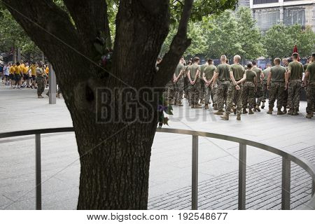 Military Freedom Run: U.S. Marine Corps personnel gather by the reflecting pools at the National September 11 Memorial site after the Freedom Run. Fleet Week, NEW YORK MAY 26 2017