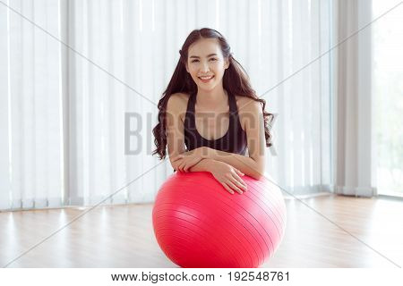 Healthy Woman With Fit Ball In Gym Or Yoga Class.