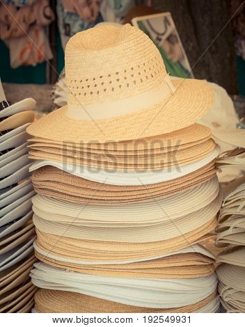 Collection Of Handmade Straw Hats On Stall At Bazaar