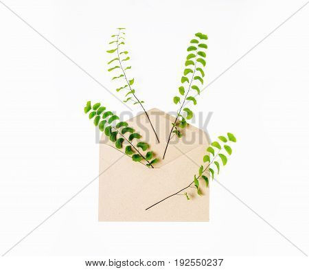 envelope and a present in eco paper on white background