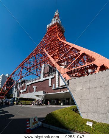 Tokyo Japan - NOV 12 2017: Tokyo tower in close up view with tourist group taking photo near tokyo tower entrance in Tokyo Japan.