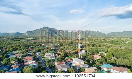 aerial view of tower mobile phone in village communication technology