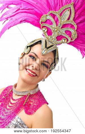 Beauty Brunette Woman with Perfect Makeup. Beautiful Professional Make-up perfect headdress with natural feathers and rhinestones. Beautiful Girl in carnival costume isolated on white background.