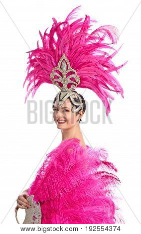 Beautiful woman in carnival costume with pink feathers and rhinestones.Beautiful professional make-up perfect headdress with natural feathers isolated on white background.
