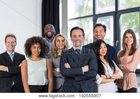 Boss And Business People Group With Mature Leader On Foreground In Office, Leadership Concept, Successful Mix Race Team Of Businesspeople Wearing Suits, Professional Staff Happy Smiling