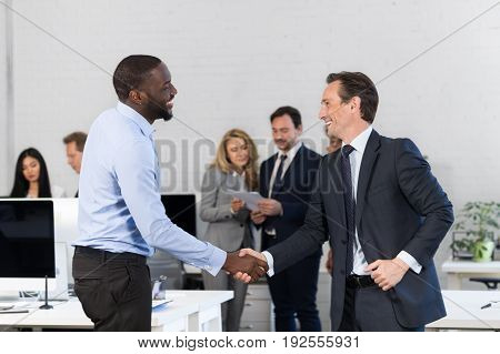 Handshake, Businessmen Shaking Hands During Meeting, Agreement In Front Of Business People Discussion Of Contract In Office, Two Leaders Over Businesspeople Team Making Deal