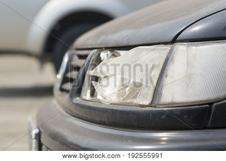 damaged car headlamp after collision on the road