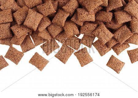 Chocolate pads corn flakes isolated with copy space background.