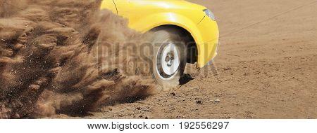 Rally race car splash dust  on the track