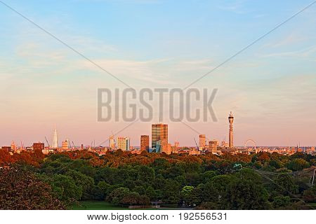 London at dusk viewed from Primrose Hill United Kingdom with many major landmarks in sight