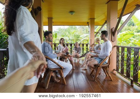 Woman Hold Man Hand Enter Summer Terrace With People Group Talking, Friends Outdoors Happy Smiling Communication