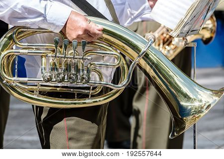 Musician Of Military Brass Band Holding Tuba In His Hand