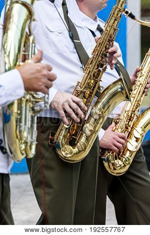 Military Orchestra Musicians Playing Saxophones During Brass Bands Festival
