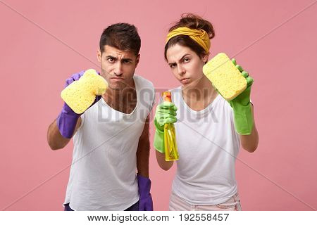 Determined And Serious Young European Male And Female Obsessed With Hygiene And Cleanness Sharing Ho