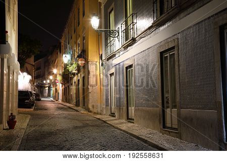 Night view of the narrow streets of old Lisbon Portugal
