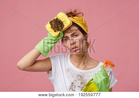People, Housework, Home And Tiredness Concept. Exhausted Female In Protective Rubber Gloves And Casu