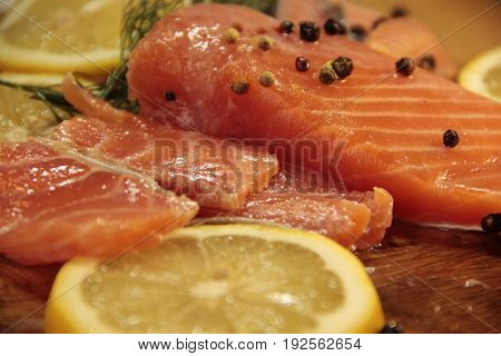 Salmon trout lemon on the table prepared, slice, cutting, preparation