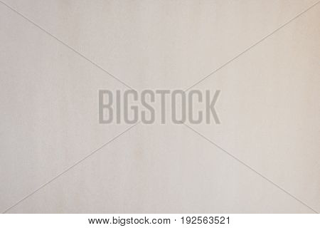 Paper texture wallpaper background in light brown color (bisque or blanched almond color) for gift wrapping decoration design or model creation as natural paper background for text or wording space