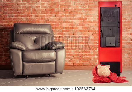 Energy savings concept. Solid fuel boiler and piggy bank with armchair on brick wall background