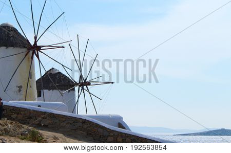 The historic windmills in the Little Venice area of Mykonos Town on a sunny day in Mykonos, Greece