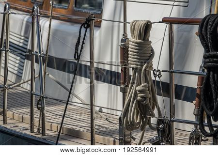 Rope pulley blocks marine vintage on an old Sailboat. Nautical detail on a dark background