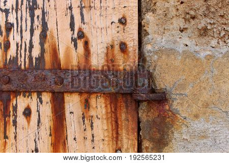 Naturally weathered, orange rusted metal and wood door, Ibiza