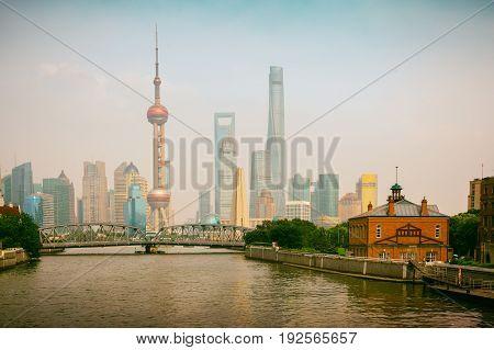 Shanghai skyline with historical Waibaidu bridge Shanghai China