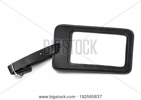 Black leather luggage tag isolated on white background