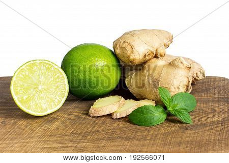 Detail Of Whole And Cut Fresh Ginger With Lime