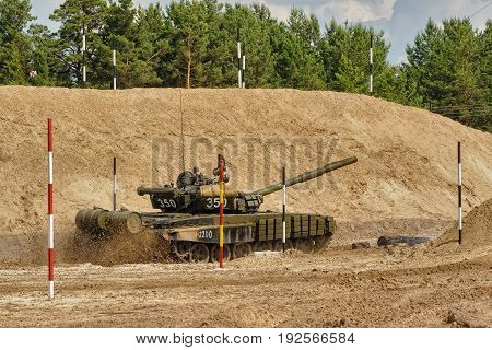 Tyumen, Russia - June 21, 2017: Army Games. Safe Route contest. Tank T-72 tank in action