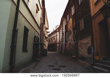 pathway in old town between tenement houses