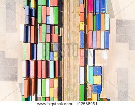 Aerial view of containers at railway. Industrial background. Industry from above. Business and transportation