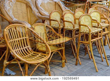Chairs from rattan wicker furniture in the street market