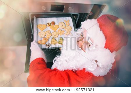 Funny Santa Claus Baking A Cookies In Oven