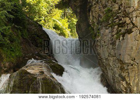 Waterfall in Ski resort Bad Gastein Austria Salzburg.