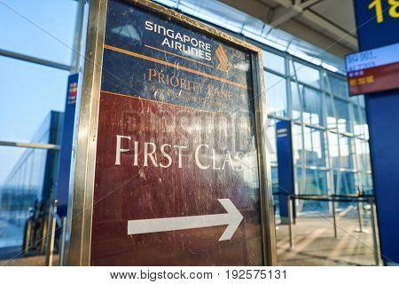 HONG KONG - CIRCA SEPTEMBER, 2016: First Class boarding sign at Hong Kong International Airport.