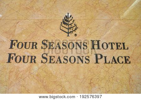 HONG KONG - CIRCA SEPTEMBER, 2016: close up shot of Four Seasons Hotel Hong Kong sign. Four Seasons Hotel Hong Kong is a five-star hotel building in the Sun Hung Kai Properties.