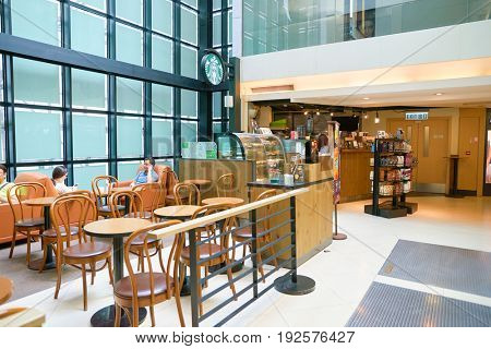 HONG KONG - CIRCA SEPTEMBER, 2016:  Starbucks coffee shop in Hong Kong. Starbucks Corporation is an American coffee company and coffeehouse chain.