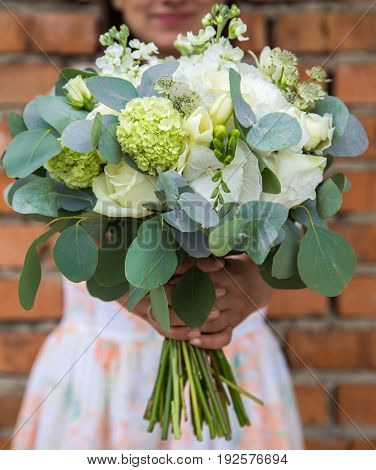 A beautiful bouquet in the girl's hands ,close-up ,holiday concept