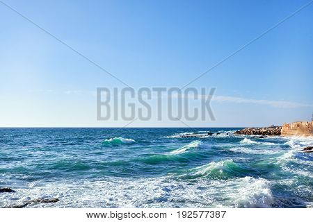 Beautiful view of sea and beach background with breakwater