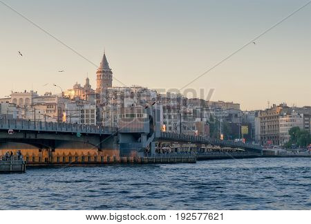 Istanbul Turkey - April 26 2017: City view of Istanbul overlooking Galata bridge and Galata Tower at dusk time