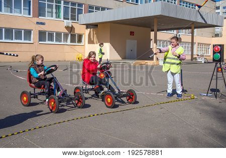 Voronezh, Russia - April 26, 2017: Schoolchildren play on the site according to the rules of the road